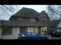 single storey wrap around extension and loft conversion with detached double garage by DKM Consultants